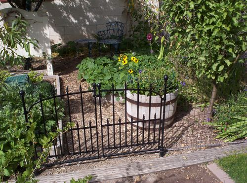 Orchard garden gate and flowers